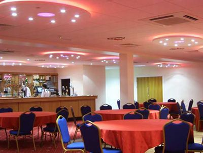 Conference room with bar, illuminated by  concealed lighting – xenon lights, strip lighting